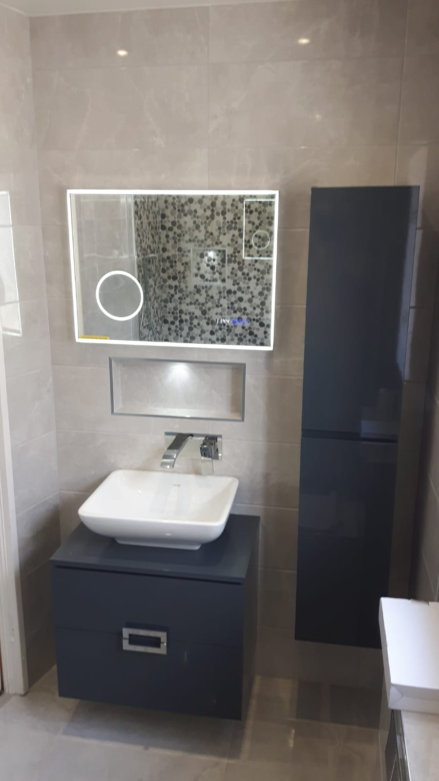 Bathroom With Pebble Mosaic Tiling
